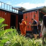 Monk outside shipping container home